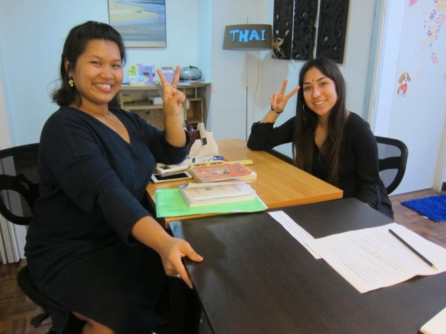 Teacher Mo with our American student learning Thai Script